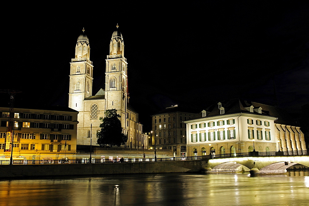 "The landmark of Zurich, the twin towers of the Grossmuenster Church, and the Wasserkirche, ""Water Church"" to the right, the Limmat River flows under the Muenster bridge, Zurich, Switzerland, Europe"