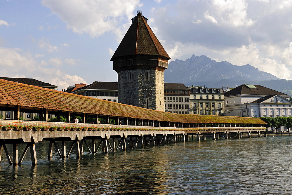 Chapel Bridge over Reuss River in Lucerne, Pilatus Mountain looming above the city at back, Canton of Lucerne, Switzerland, Europe