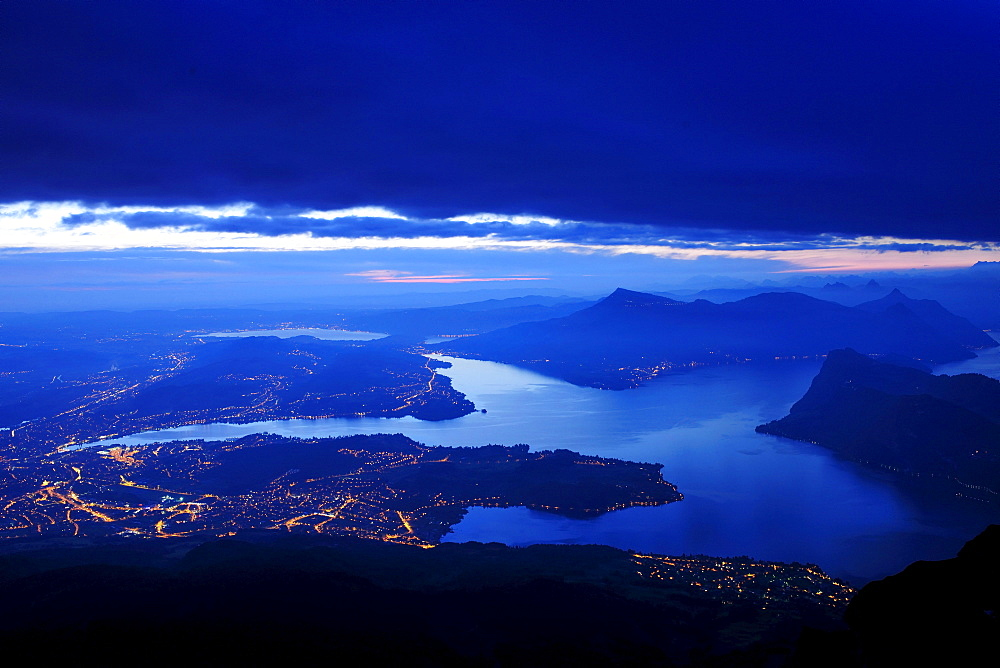 View in the early morning from Mount Pilatus on Lake Lucerne and the city of Lucerne, Switzerland, Europe
