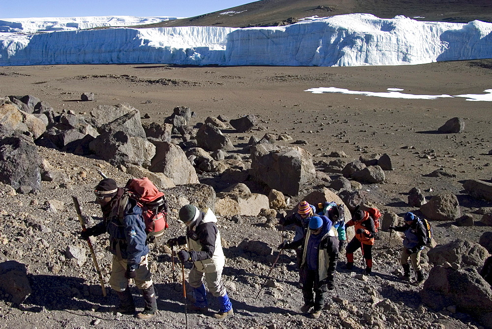 Mountaineer and local guide at the ascent to the summit of the Kilimanjaro via the Western Breach route, Tanzania, Africa
