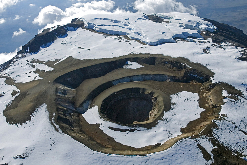 Aerial view of Mt. Kilimanjaro 19335 ft or 5895 m, Reusch crater with ash cone and pit, Tanzania, Africa