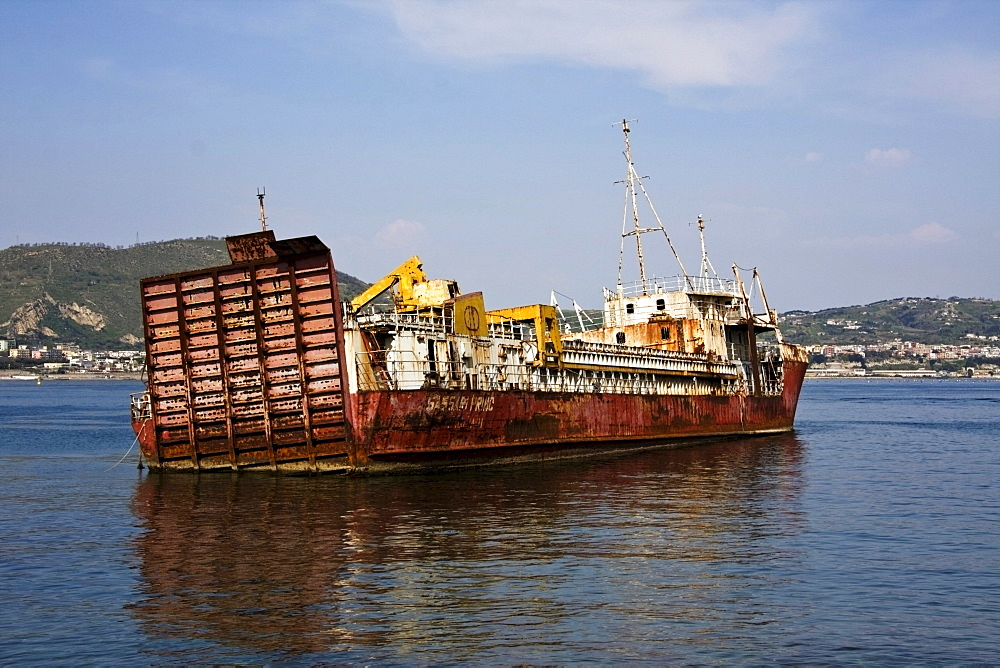Sunken cargo ship in the port of Bacoli, Pozzuoli, Naples, Italy, Europe
