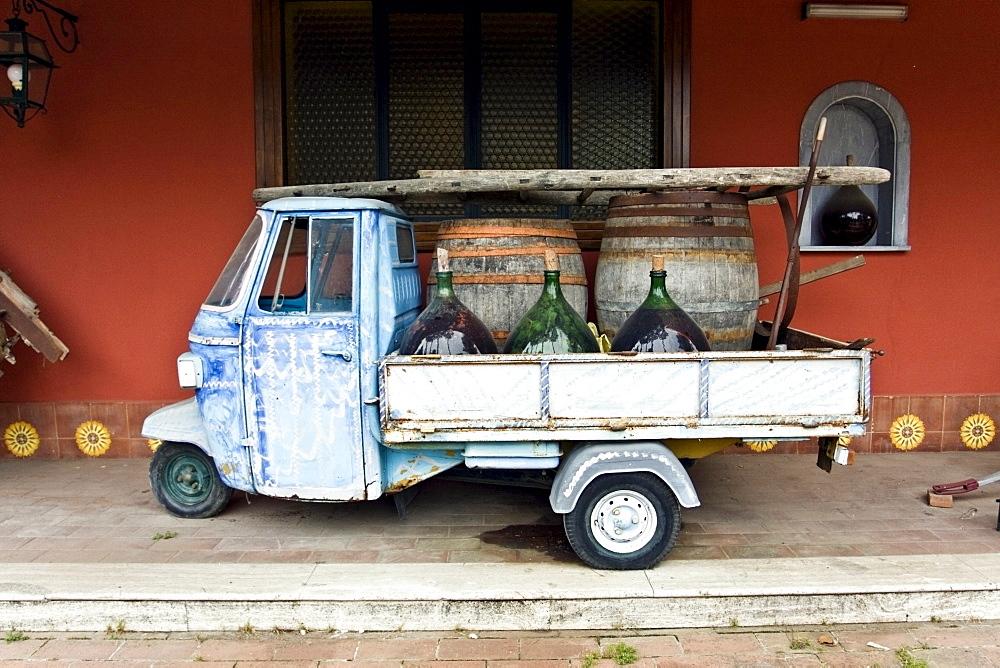Old Ape Piaggio Van for wine transportation