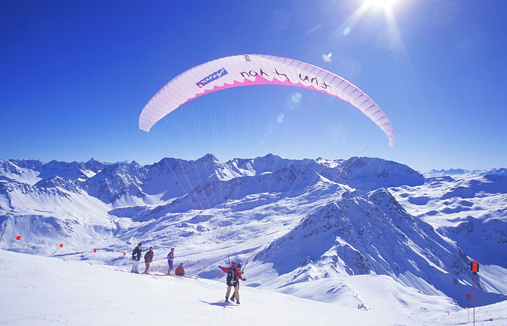Paraglider on Mt. Weisshorn in winter, paragliding, tandem flight, mountain panorama, Arosa, Grisons, Switzerland, Europe