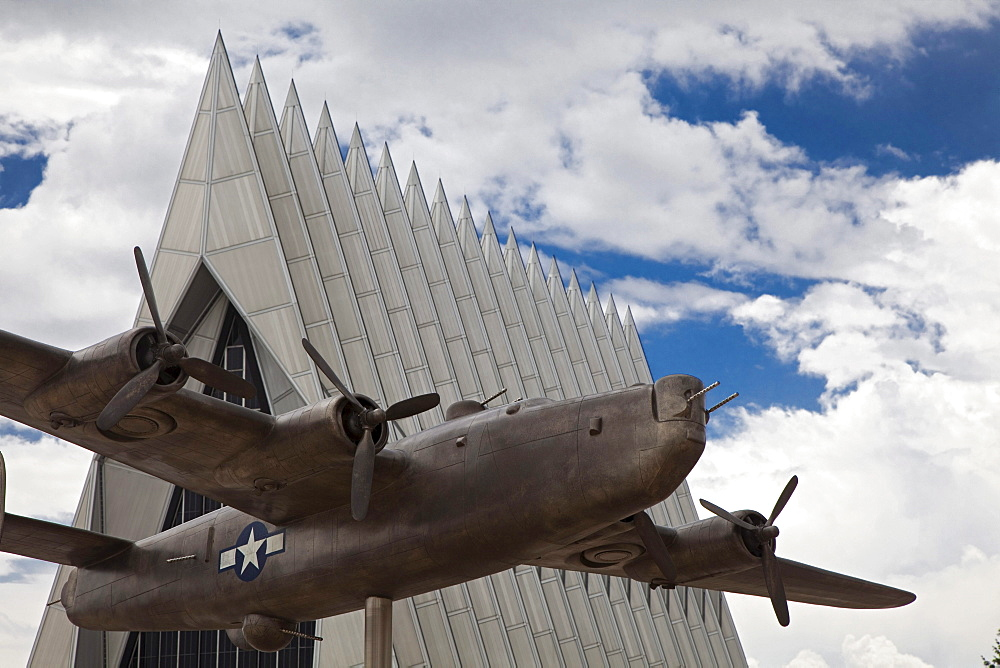 A model of a B-24 Liberator, a bomber used in World War II, in front of the Cadet Chapel at the United States Air Force Academy, Colorado Springs, Colorado, USA