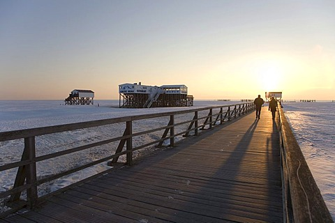 Winterly snow-covered sea bridge in St Peter-Ording on the North Sea, Eiderstedt Peninsula, Nordfriesland, Schleswig-Holstein, Northern Germany, Germany, Europe