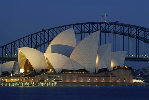 Sydney Opera House with Sydney Harbor Bridge in the back at night, Sydney, New South Wales, Australia