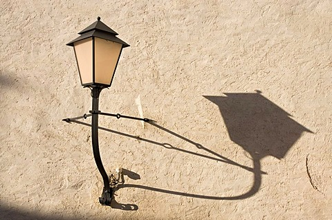 Lamp on Festung Hohensalzburg, the castle of Salzburg, and its shadow on the wall, Austria, Europe