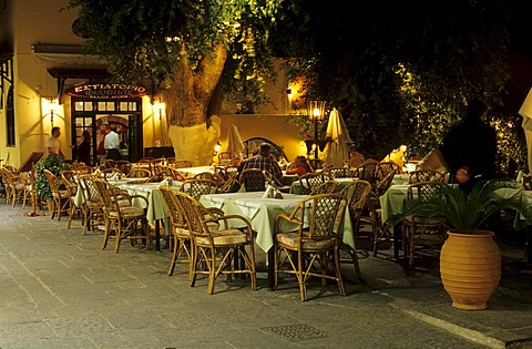 Evening atmosphere in a restaurant in the historic centre of Rhodes City, Rhodes Island, Greece, Europe