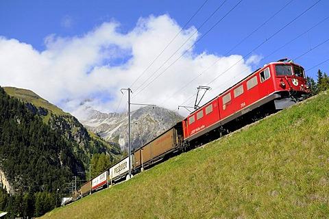 Rhaetische Bahn RhB Railway freight train travelling on the Albula stretch between Berguen and Preda, Graubuenden, Switzerland, Europe