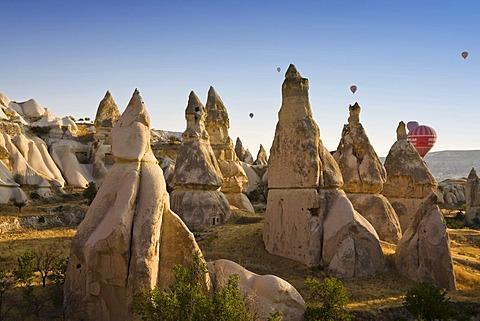 Hot air balloons and tuff rock landscape near Goereme, Cappadocia, Central Anatolia, Turkey, Asia