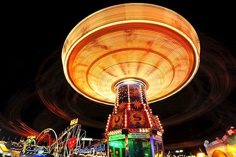 Chain carousel at night, Oktoberfest, Munich, Bavaria, Germany, Europe