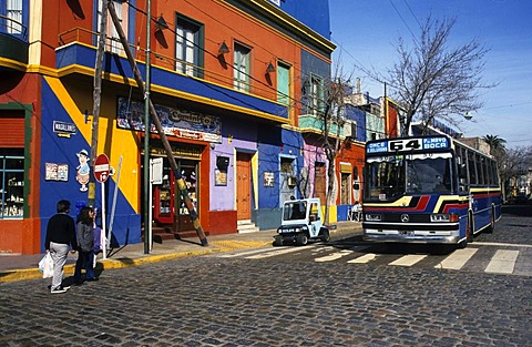 Bus in front of a colourful house facade in the dockland area La Boca, Buenos Aires, Argentina, South America
