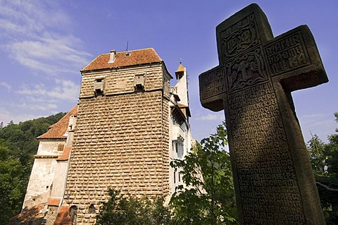 Bran Castle or Draculaís Castle, stone cross at front, Wallachia, Carpathian Mountains, Romania