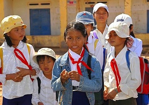 School children wearing pioneer clothing with red ties around their necks, Vietnam, Asia