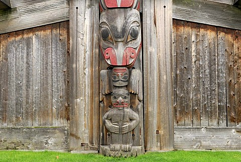 Totem pole integrated in a longhouse, Royal BC Museum, Victoria, British Columbia, Canada, North America