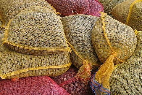 Stacked nets filled with with feed for game