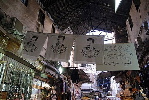 Flags with portrait of president Baschar-al-Assad in the souk in the historic city centre of Damascus, Syria, Middle East, Asia