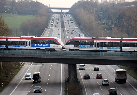 Local train, commuter train, crossing the A3 motorway near Mettman, Erkrath, North Rhine-Westphalia, Germany, Europe