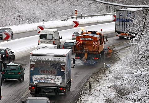 Snow plough in operation, traffic jam after heavy snow fall, motorway Autobahn A40, Ruhr expressway between Duisburg and Essen, near Muelheim, North Rhine-Westphalia, Germany, Europe