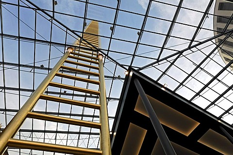 Golden ladder soaring into the sky, through glass roof, artistic landmark of the new Forum Duisburg Shopping Centre, Shopping Mall, city centre, Ruhr area, North Rhine-Westphalia, Germany, Europe - Propertyrights MultiMallManagementDuisburgGmbH