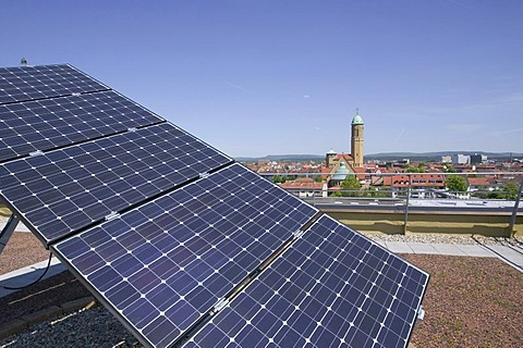 Solar installation on the roof of the Bamberg public utility company, behind it the Otto church, Bamberg, Bavaria, Germany, Europe
