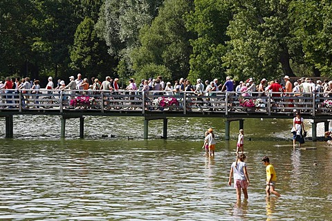 Steamer landing stage full of people in Herrsching on Lake Ammersee, Fuenfseenland, Upper Bavaria, Germany, Europe