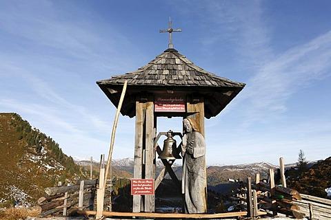 Wishing bell near Glockenhuette mountain on Nockalm Road, Nockberge National Park, Carinthia, Austria, Europe
