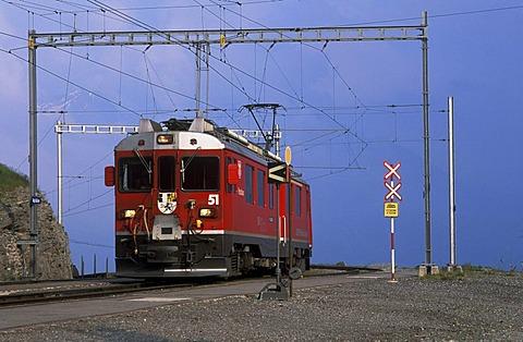 Bernina Express in Alp Gruem, Val Poschiavo, Bernina, Graubuenden, Switzerland, Europe