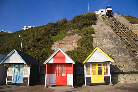 Beach huts and the car of the West Cliff Lift, funicular railway, Bournemouth, Dorset, England, United Kingdom