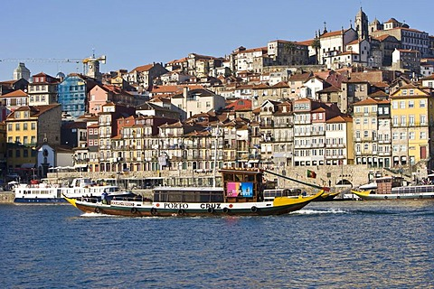 Typical tourist boat on the Duoro River, at back the Ribeira Quay, Porto, UNESCO World Cultural Heritage Site, Portugal, Europe