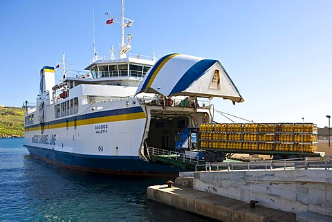 Ferry from Malta being loaded with vehicles with hazardous materials, port of Mgarr, Mgarr, Gozo, Malta, Europe