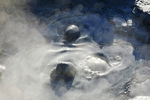 Hot, bubbling mud in a pool in the Gunnuhver geothermal area, Iceland, Europe