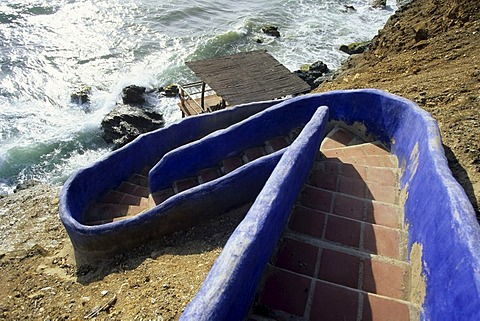 Blue stairs towards the water, Caribbean Sea, near Guarame, Isla de Margarita, The Caribbean, Venezuela, South America