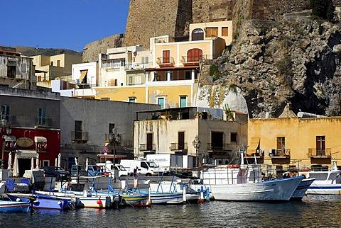 Small fishing boats and houses in the port of Marina Corta in the city of Lipari on Lipari Island, Aeolian or Lipari Islands, Tyrrhenian Sea, South Italy, Italy, Europe