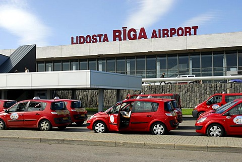 Red taxis in front of the Airport building, Lidosta Riga Airport, Riga, Latvia, Baltic States, Northeast Europe