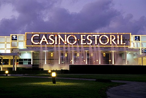 Estoril Casino in the evening, modern architecture, illuminated facade, spa gardens of Estoril, sophisticated sea resort, Lisbon, Lisboa, Portugal, Europe