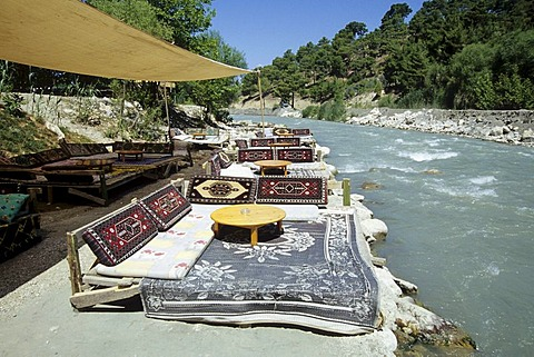 Cafe terrace at the river bed of the Esen Cay River in a nature reserve, Saklikent, Akdagi Mountains, Fethiye, Mugla Province, Turkey