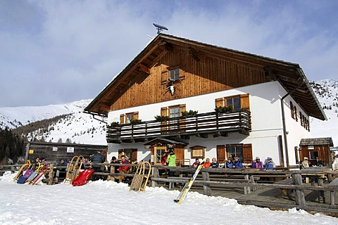 Hikers taking a break at the Alpe Nemes mountain hut in the High Puster Valley or Alto Pusteria, Bolzano-Bozen, Italy, Europe