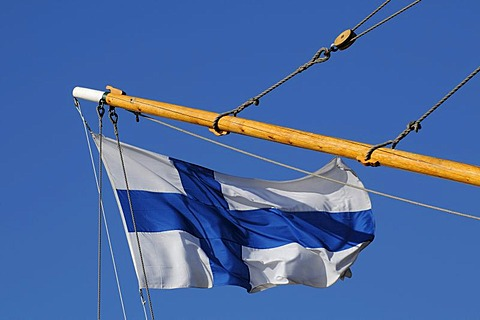 Finnish flag on a sailing ship in the port of Helsinki, Finland, Europe