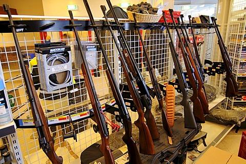 Shot guns in a Tasiilaq supermarket, Ammassalik, East Greenland, Greenland