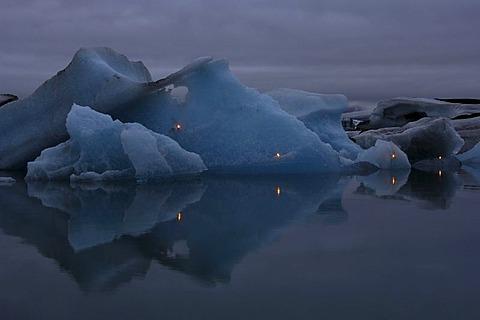 Candlelights, fireworks on icebergs, glacier, Joekulsarlon, Iceland, Europe