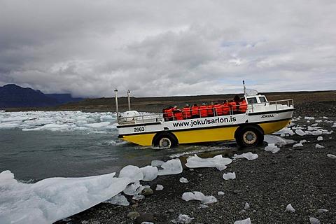 Amphibious vehicle between icebergs, glacier, Joekulsarlon, Iceland, Europe