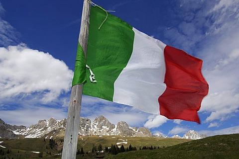 Italian flag at Groedner Joch, Dolomite Alps, South Tyrol, Italy, Europe