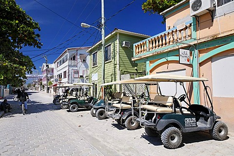 Golf carts parked on the main street, the most popular form of transport in San Pedro, Ambergris Cay Island, Belize, Central America, Caribbean