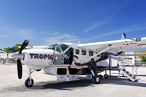 Cessna 208 Caravan with open baggage compartments, Tropic Air, on the local airfield of San Pedro, Ambergris Cay Island, Belize, Central America, Caribbean