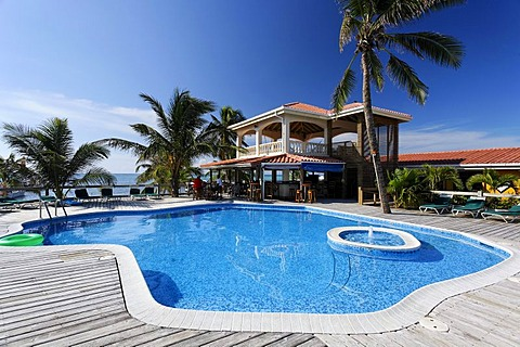 Swimming pool and restaurant of the Sun Breeze Hotel, San Pedro, Ambergris Cay Island, Belize, Central America, Caribbean