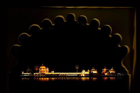 View of Lake Piccola and Jagmandir Island from the Lake Palace Hotel, Udaipur, Rajasthan, North India, Asia