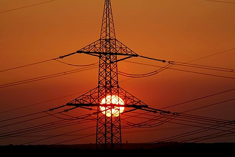 Sunset behind electricity pylon, Ruhr area, Germany, Europe