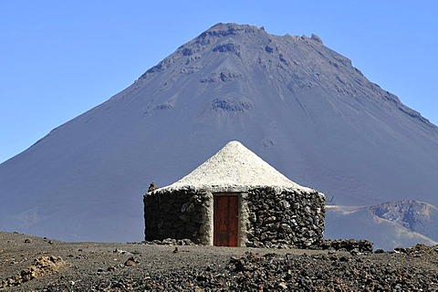 Traditional hut in front of the Pico de Fogo Volcano, Cha das Caldeiras, Fogo Island, Cape Verde Islands, Africa